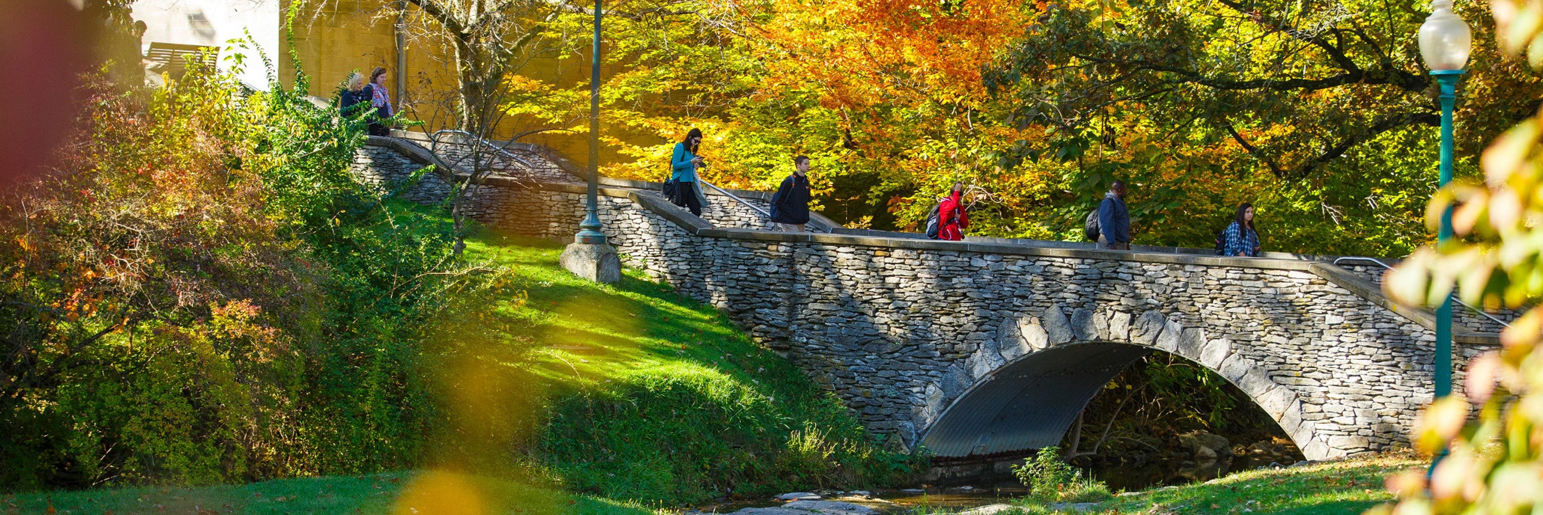 stone bridge with students walking up and down the bridge