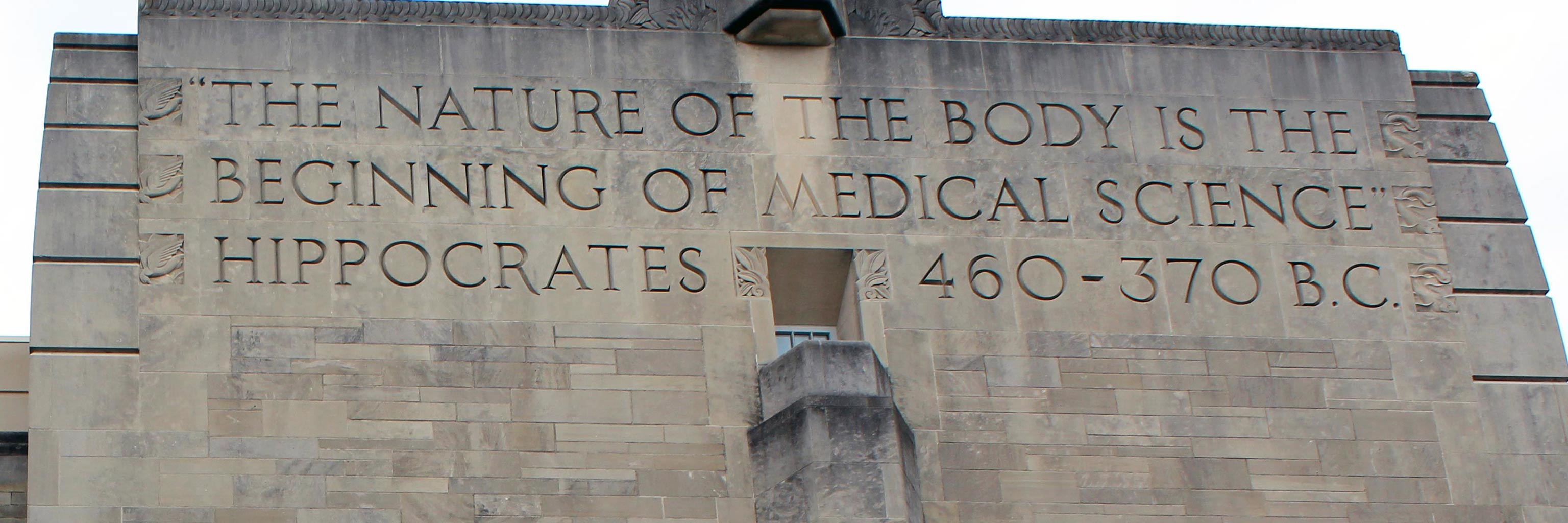 large stone building with carving, the nature of the body is the beginning of medical science, Hippocrates, 460-370 b.c.